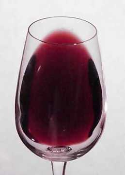 The color of a red wine in a tilted glass