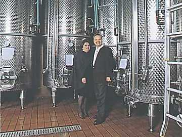 Mr. and Mrs. Santarelli in their cellar
