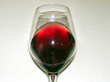 A glass of Barolo: it can be noticed the high transparency and nuances of garnet red color, not so different from Pinot Noir