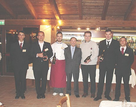Locanda dei Golosi's staff and, center picture, Emilio Ridolfi and Antonello Biancalana