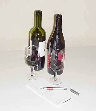 Bottles, glasses, a pen and a block notes - or a computer - everything you need to narrate a wine