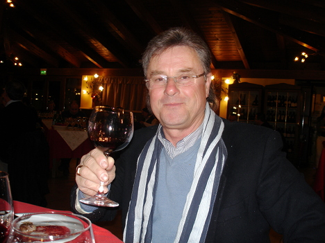 Costantino Romanelli with a glass of Montefalco Sagrantino Medeo 2012